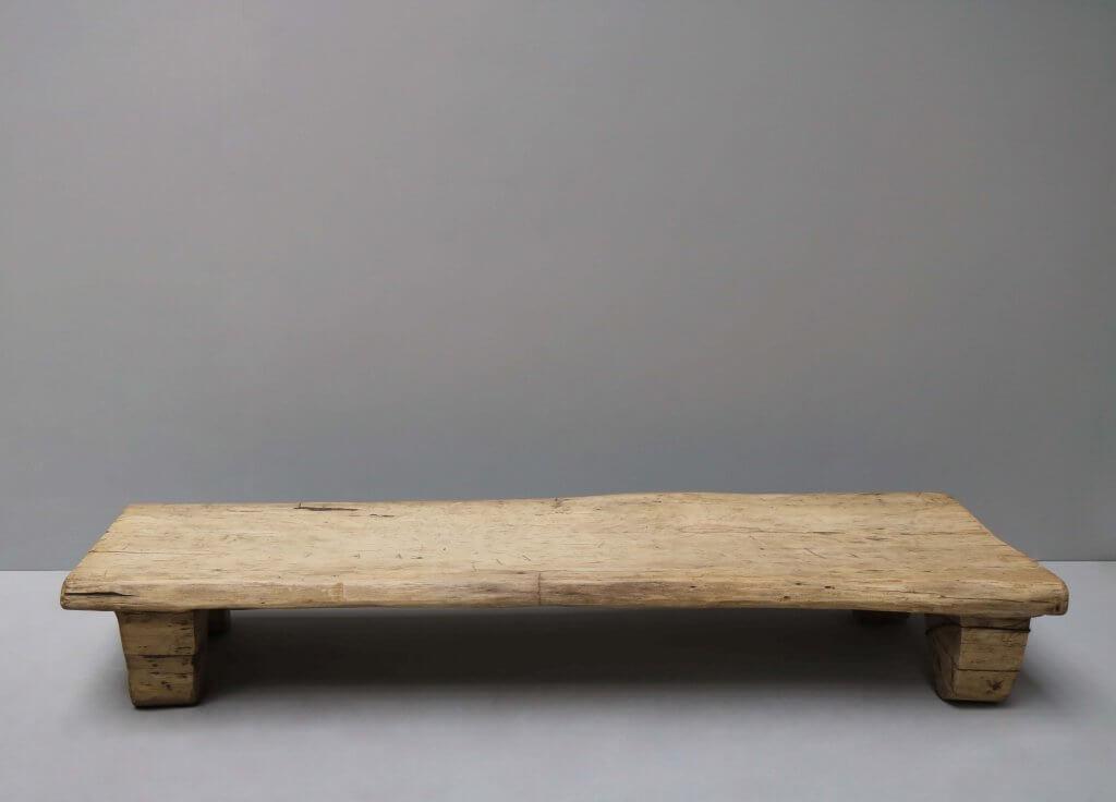 Antique wooden tribal table for unique interior design