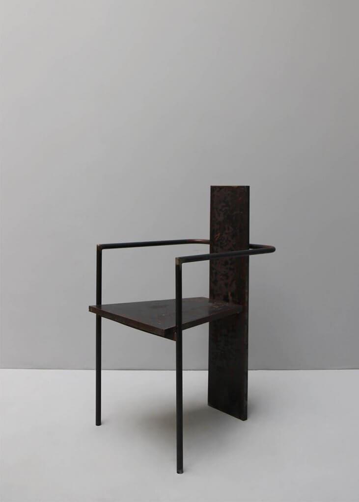 Iconic concrete chair by designer Jonas Bohlin in cast iron at studio oliver gustav