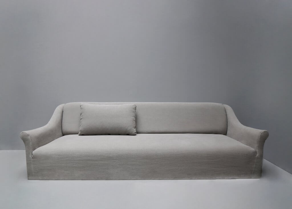 New Couch is a minimalistic sofa in hemp or linen upholstery by Studio Oliver Gustav